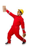 The construction worker with clay bricks on white Royalty Free Stock Photo