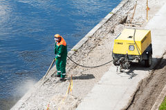 Construction worker cleaning concrete Royalty Free Stock Photo