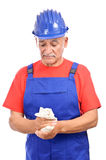 Construction worker cleaning dirty hands Stock Photos