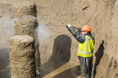 Construction Worker Cleaning Foundation Royalty Free Stock Photos
