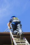 Construction Worker Climbing Ladder Royalty Free Stock Photography