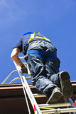 Construction worker climbing ladder Stock Image