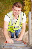 Construction Worker Climbing Ladder On Building Site Stock Image