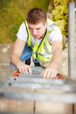 Construction Worker Climbing Ladder On Building Site Stock Images