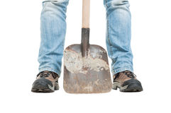 Construction worker in close-up holding shovel Royalty Free Stock Photos
