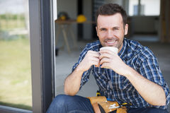 Construction worker during coffee break Stock Photography