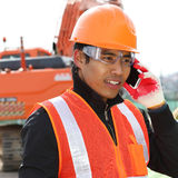 Construction worker communication with mobile phone Royalty Free Stock Photography