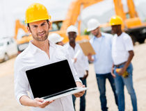Construction worker with a computer Royalty Free Stock Photo