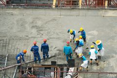 Construction worker Concrete pouring during commercial concretin royalty free stock image
