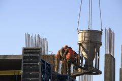 Concrete pouring during commercial concreting floors of building in construction site and Civil Engineer stock photos