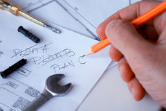 A construction worker on a construction site check new plan Stock Photography