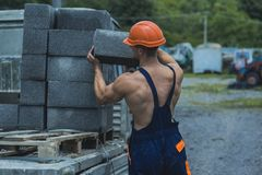 Construction worker. Construction worker carry bricks. Construction worker unload truck. Construction worker in working. Uniform. Building tomorrow world today stock photography