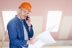 Construction worker consulting with somebody Stock Photo
