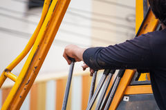 Construction worker controls of lifting crane Stock Images