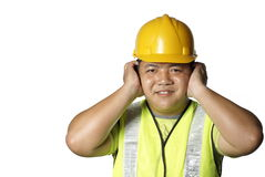 Construction worker cover ears Stock Photos