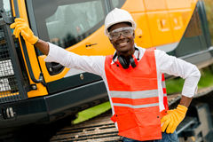 Construction worker with a crane Stock Photo
