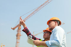Construction worker and cranes Royalty Free Stock Photos