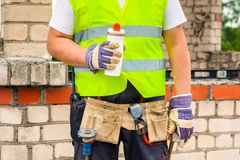 Construction worker with cup of coffee Royalty Free Stock Photography