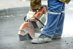 Construction worker with cut-off machine Royalty Free Stock Images
