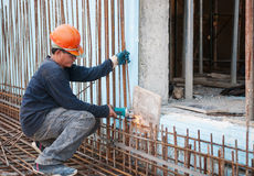 Construction worker cutting steel rods Stock Photos