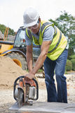 Construction Worker Cutting Stone With Circular Saw Stock Image