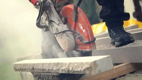 Construction Worker Cutting Stone