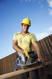 Construction Worker Cutting Wood Royalty Free Stock Photography