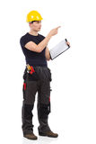 Construction worker directing. Construction worker in yellow helmet holding clipboard and directing.  Full length studio shot isolated on white Stock Image