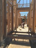 Construction worker doing the framing for the house. Construction worker doing the framing for a new house stock photo