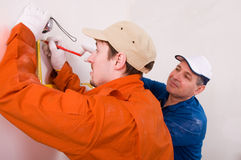 Construction worker doing measuring. Two Construction worker doing measuring Stock Photo