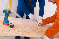 Construction worker doing measuring. Two Construction worker doing measuring Royalty Free Stock Photo