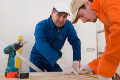 Construction worker doing measuring Royalty Free Stock Photos