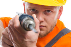 Construction worker with drill. Isolated Royalty Free Stock Images