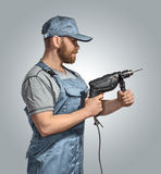 Construction worker with drill on the isolated background Stock Photo