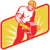 Construction Worker Drilling with Jack Hammer. Illustration of a construction worker at work operating a jackhammer facing front with sunburst in the background Royalty Free Stock Images
