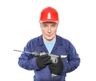 Construction worker with drilling machine Stock Photo