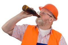Construction worker drinking beer Stock Photo