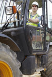 Construction Worker Driving Digger Royalty Free Stock Photos