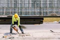Construction worker electric drill Drilling concrete ground in royalty free stock image