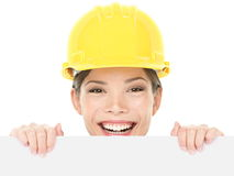Construction worker / engineer woman showing sign stock photos