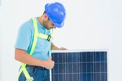 Construction worker examining solar panel Stock Images