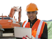 Construction worker and excavator Royalty Free Stock Photos
