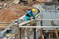 A construction worker fabricating beam formwork Royalty Free Stock Photography