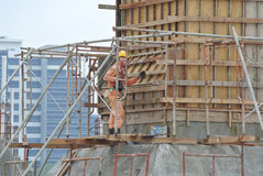 A construction worker fabricating beam formwork Royalty Free Stock Images