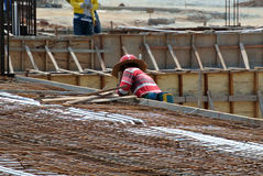 A construction worker fabricating beam formwork Royalty Free Stock Photo