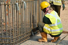 Construction worker fabricating pile cap steel reinforcement bar Royalty Free Stock Photo