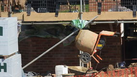 Construction  worker filling a cement mixer. stock video