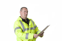 Construction worker in flourescent jacket. Construction worker upper torso profile in flourescent jacket Stock Photography
