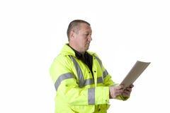 Construction worker in flourescent jacket. Construction worker upper torso profile in flourescent jacket stock images