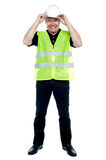 Construction worker in fluorescent jacket Stock Photos